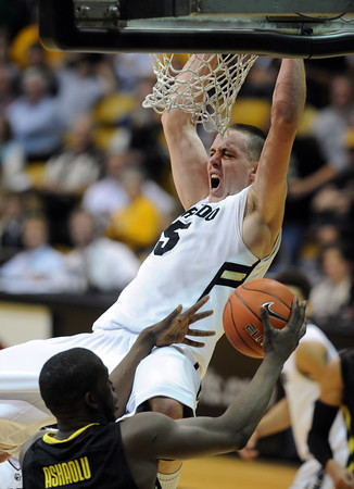 """Shane Harris-Tunks of CU dunks over Olu Ashaolu of Oregon<br /> during the second half of the February 4, 2012 game in Boulder.<br /> For more photos of the game, go to  <a href=""""http://www.dailycamera.com"""">http://www.dailycamera.com</a>.<br /> February 4, 2012 / Cliff Grassmick"""