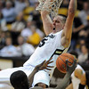 "Shane Harris-Tunks of CU dunks over Olu Ashaolu of Oregon<br /> during the second half of the February 4, 2012 game in Boulder.<br /> For more photos of the game, go to  <a href=""http://www.dailycamera.com"">http://www.dailycamera.com</a>.<br /> February 4, 2012 / Cliff Grassmick"