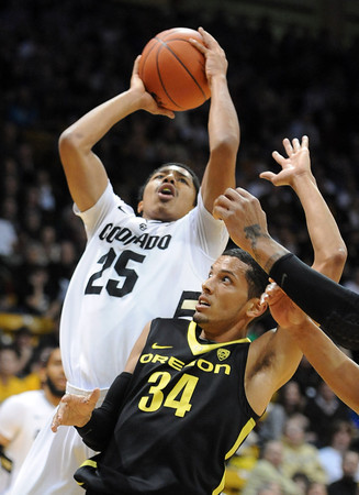 """Spencer Dinwiddie of Colorado shoots over Devoe Joseph of Oregon<br /> during the first half of the February 4, 2012 game in Boulder.<br /> For more photos of the game, go to  <a href=""""http://www.dailycamera.com"""">http://www.dailycamera.com</a>.<br /> February 4, 2012 / Cliff Grassmick"""