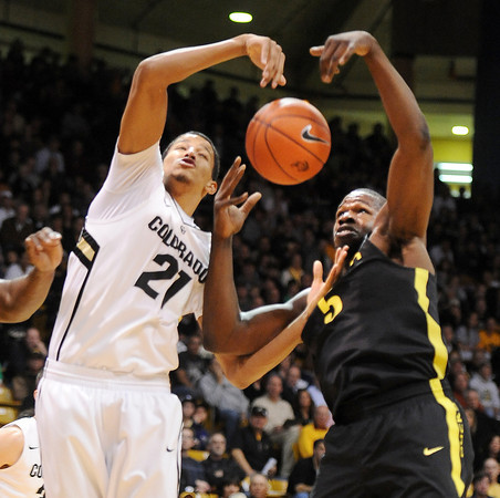 "Andre Roberson, left, of Colorado, and Olu Ashaolu of Oregon, both try to control a rebound during the first half of the February 4, 2012 game in Boulder.<br /> For more photos of the game, go to  <a href=""http://www.dailycamera.com"">http://www.dailycamera.com</a>.<br /> February 4, 2012 / Cliff Grassmick"