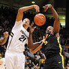 """Andre Roberson, left, of Colorado, and Olu Ashaolu of Oregon, both try to control a rebound during the first half of the February 4, 2012 game in Boulder.<br /> For more photos of the game, go to  <a href=""""http://www.dailycamera.com"""">http://www.dailycamera.com</a>.<br /> February 4, 2012 / Cliff Grassmick"""