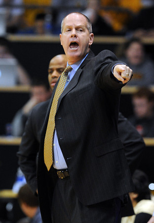 """Tad Boyle directs the Buffs against Oregon<br /> during the first half of the February 4, 2012 game in Boulder.<br /> For more photos of the game, go to  <a href=""""http://www.dailycamera.com"""">http://www.dailycamera.com</a>.<br /> February 4, 2012 / Cliff Grassmick"""