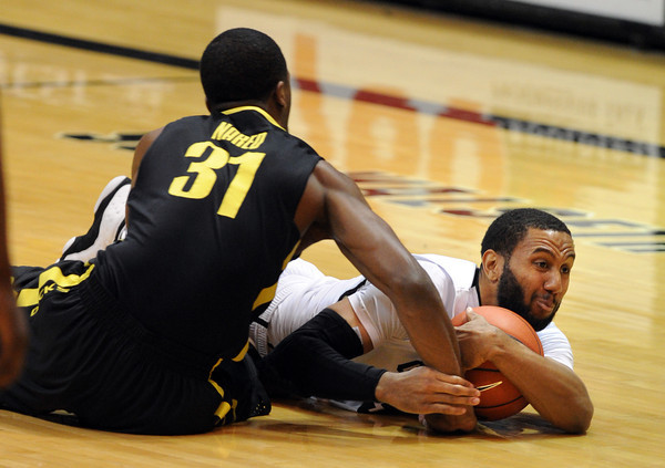 """Carlon Brown of CU gets the loose ball from Tyrone Nared of Oregon<br /> during the second half of the February 4, 2012 game in Boulder.<br /> For more photos of the game, go to  <a href=""""http://www.dailycamera.com"""">http://www.dailycamera.com</a>.<br /> February 4, 2012 / Cliff Grassmick"""