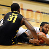 "Carlon Brown of CU gets the loose ball from Tyrone Nared of Oregon<br /> during the second half of the February 4, 2012 game in Boulder.<br /> For more photos of the game, go to  <a href=""http://www.dailycamera.com"">http://www.dailycamera.com</a>.<br /> February 4, 2012 / Cliff Grassmick"
