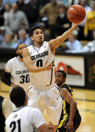 """Askia Booker of Colorado drives past the Oregon defense<br /> during the second half of the February 4, 2012 game in Boulder.<br /> For more photos of the game, go to  <a href=""""http://www.dailycamera.com"""">http://www.dailycamera.com</a>.<br /> February 4, 2012 / Cliff Grassmick"""