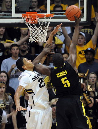 "Andre Roberson of Colorado goes up for the block on Olu Ashaolu of Oregon during the second half of the February 4, 2012 game in Boulder.<br /> For more photos of the game, go to  <a href=""http://www.dailycamera.com"">http://www.dailycamera.com</a>.<br /> February 4, 2012 / Cliff Grassmick"