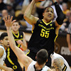 """Tony Woods of Oregon, shoots over Austin Dufault of Colorado<br /> during the first half of the February 4, 2012 game in Boulder.<br /> For more photos of the game, go to  <a href=""""http://www.dailycamera.com"""">http://www.dailycamera.com</a>.<br /> February 4, 2012 / Cliff Grassmick"""