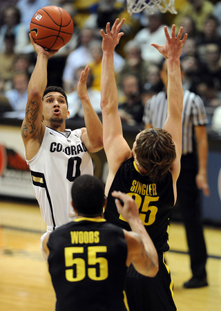 "Askia Booker of CU puts up a shot over E.J Singler of Oregon<br /> during the second half of the February 4, 2012 game in Boulder.<br /> For more photos of the game, go to  <a href=""http://www.dailycamera.com"">http://www.dailycamera.com</a>.<br /> February 4, 2012 / Cliff Grassmick"