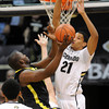 """Andre Roberson (21) of Colorado goes up to block the shot of Olu Ashaolu of Oregon during the first half of the February 4, 2012 game in Boulder.<br /> For more photos of the game, go to  <a href=""""http://www.dailycamera.com"""">http://www.dailycamera.com</a>.<br /> February 4, 2012 / Cliff Grassmick"""