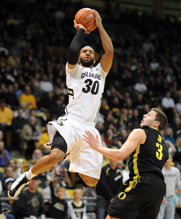 """Carlon Brown of Colorado shoots over Garrett Sim of Oregon,<br /> during the first half of the February 4, 2012 game in Boulder.<br /> For more photos of the game, go to  <a href=""""http://www.dailycamera.com"""">http://www.dailycamera.com</a>.<br /> February 4, 2012 / Cliff Grassmick"""