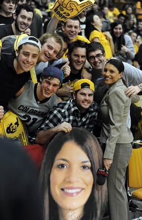 """Alanna Rizzo, right, of ROOT Sports TV Network, says to goodbye to CU students in the C-unit section. She is moving on to another TV job.<br /> For more photos of the game, go to  <a href=""""http://www.dailycamera.com"""">http://www.dailycamera.com</a>.<br /> February 4, 2012 / Cliff Grassmick"""