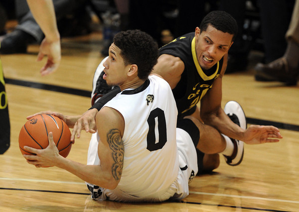 """Askia Booker (0) of Colorado comes up with a loose ball from Devoe Joseph of Oregon during the second half of the February 4, 2012 game in Boulder.<br /> For more photos of the game, go to  <a href=""""http://www.dailycamera.com"""">http://www.dailycamera.com</a>.<br /> February 4, 2012 / Cliff Grassmick"""