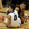 "Askia Booker (0) of Colorado comes up with a loose ball from Devoe Joseph of Oregon during the second half of the February 4, 2012 game in Boulder.<br /> For more photos of the game, go to  <a href=""http://www.dailycamera.com"">http://www.dailycamera.com</a>.<br /> February 4, 2012 / Cliff Grassmick"