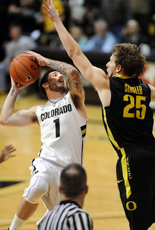 "Nate Tomlinson of Colorado was fouled by E.J. Singler  win one second left in a tie game.<br />   Tomlinson hit a free throw to win the game 72-71 on February 4, 2012 in Boulder.<br /> For more photos of the game, go to  <a href=""http://www.dailycamera.com"">http://www.dailycamera.com</a>.<br /> February 4, 2012 / Cliff Grassmick"