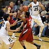 "Chasson Randle of Stanford is trapped by Sabatino Chen and Spencer Dinwiddie of CU during the second half of the January 24th, 2013 game in Boulder.<br /> For more photos of the game, go to  <a href=""http://www.dailycamera.com"">http://www.dailycamera.com</a>.<br /> Cliff Grassmick / January 24, 2013"