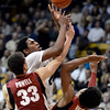 "University of Colorado's Xavier Johnson takes a shot over Dwight Powell and Josh Huestis during a game against Stanford on Thursday, Jan. 24, at the Coors Event Center on the CU campus in Boulder. For more photos of the game go to  <a href=""http://www.dailycamera.com"">http://www.dailycamera.com</a><br /> Jeremy Papasso/ Camera"