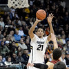 "University of Colorado's Andre Roberson shoot a three-pointer over Dwight Powell during a game against Stanford on Thursday, Jan. 24, at the Coors Event Center on the CU campus in Boulder. For more photos of the game go to  <a href=""http://www.dailycamera.com"">http://www.dailycamera.com</a><br /> Jeremy Papasso/ Camera"