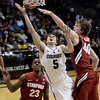 "University of Colorado's Eli Stalzer gets his shot blocked by John Gage, No. 40, during a game against Stanford on Thursday, Jan. 24, at the Coors Event Center on the CU campus in Boulder. For more photos of the game go to  <a href=""http://www.dailycamera.com"">http://www.dailycamera.com</a><br /> Jeremy Papasso/ Camera"