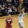 "University of Colorado's Askia Booker goes for a layup after a fast break in front of Aaron Bright, No. 2, during a game against Stanford on Thursday, Jan. 24, at the Coors Event Center on the CU campus in Boulder. For more photos of the game go to  <a href=""http://www.dailycamera.com"">http://www.dailycamera.com</a><br /> Jeremy Papasso/ Camera"