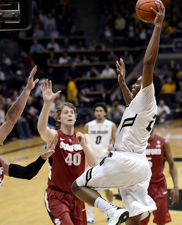 "University of Colorado's Xavier Johnson goes big for a dunk over John Gage, No. 40, and a swarm of other defenders during a game against Stanford on Thursday, Jan. 24, at the Coors Event Center on the CU campus in Boulder. For more photos of the game go to  <a href=""http://www.dailycamera.com"">http://www.dailycamera.com</a><br /> Jeremy Papasso/ Camera"