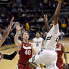 """University of Colorado's Xavier Johnson goes big for a dunk over John Gage, No. 40, and a swarm of other defenders during a game against Stanford on Thursday, Jan. 24, at the Coors Event Center on the CU campus in Boulder. For more photos of the game go to  <a href=""""http://www.dailycamera.com"""">http://www.dailycamera.com</a><br /> Jeremy Papasso/ Camera"""