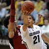 "Andre Roberson of Colorado goes o the basket past Josh Huestis of Stanford during the second half of the January 24th, 2013 game in Boulder.<br /> For more photos of the game, go to  <a href=""http://www.dailycamera.com"">http://www.dailycamera.com</a>.<br /> Cliff Grassmick / January 24, 2013"