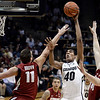 "University of Colorado's Josh Scott takes a shot over Robbie Lemons, No. 11, and John Gage, at right, during a game against Stanford on Thursday, Jan. 24, at the Coors Event Center on the CU campus in Boulder. For more photos of the game go to  <a href=""http://www.dailycamera.com"">http://www.dailycamera.com</a><br /> Jeremy Papasso/ Camera"