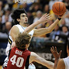 "Sabatino Chen of Colorado goes to the basket on John Gage of Stanford during the second half of the January 24th, 2013 game in Boulder.<br /> For more photos of the game, go to  <a href=""http://www.dailycamera.com"">http://www.dailycamera.com</a>.<br /> Cliff Grassmick / January 24, 2013"