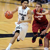 "Askia Booker of Cu drives past Aaron Bright of Stanford during the second half of the January 24th, 2013 game in Boulder.<br /> For more photos of the game, go to  <a href=""http://www.dailycamera.com"">http://www.dailycamera.com</a>.<br /> Cliff Grassmick / January 24, 2013"