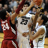 "Sabatino Chen of Colorado goes to the basket on Gabriel Harris  of Stanford during the second half of the January 24th, 2013 game in Boulder.<br /> For more photos of the game, go to  <a href=""http://www.dailycamera.com"">http://www.dailycamera.com</a>.<br /> Cliff Grassmick / January 24, 2013"