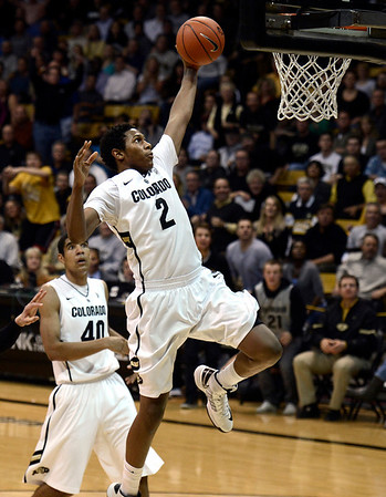 "University of Colorado's Xavier Johnson goes for a dunk during a game against Stanford on Thursday, Jan. 24, at the Coors Event Center on the CU campus in Boulder. For more photos of the game go to  <a href=""http://www.dailycamera.com"">http://www.dailycamera.com</a><br /> Jeremy Papasso/ Camera"