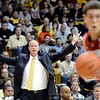 """University of Colorado Head Coach Tad Boyle signals to his team as Dwight Powell, at right, drives towards the hoop during a game against Stanford on Thursday, Jan. 24, at the Coors Event Center on the CU campus in Boulder. For more photos of the game go to  <a href=""""http://www.dailycamera.com"""">http://www.dailycamera.com</a><br /> Jeremy Papasso/ Camera"""