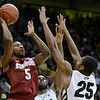 "Stanford's Chasson Randle takes a shot over Jeremy Adams, center, and Spencer Dinwiddie, No. 25, during a game against the University of Colorado on Thursday, Jan. 24, at the Coors Event Center on the CU campus in Boulder. For more photos of the game go to  <a href=""http://www.dailycamera.com"">http://www.dailycamera.com</a><br /> Jeremy Papasso/ Camera"