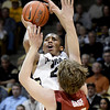 "University of Colorado's Spencer Dinwiddie shoots a three-pointer over John Gage during a game against Stanford on Thursday, Jan. 24, at the Coors Event Center on the CU campus in Boulder. For more photos of the game go to  <a href=""http://www.dailycamera.com"">http://www.dailycamera.com</a><br /> Jeremy Papasso/ Camera"