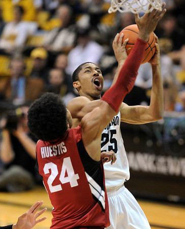 """Spencer Dinwiddie goes to the basket against Stanford during the second half of the January 24th, 2013 game in Boulder.<br /> For more photos of the game, go to  <a href=""""http://www.dailycamera.com"""">http://www.dailycamera.com</a>.<br /> Cliff Grassmick / January 24, 2013"""