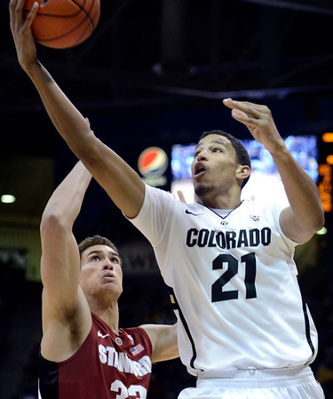 "University of Colorado's Andre Roberson goes for a layup over Dwight Powell during a game against Stanford on Thursday, Jan. 24, at the Coors Event Center on the CU campus in Boulder. For more photos of the game go to  <a href=""http://www.dailycamera.com"">http://www.dailycamera.com</a><br /> Jeremy Papasso/ Camera"
