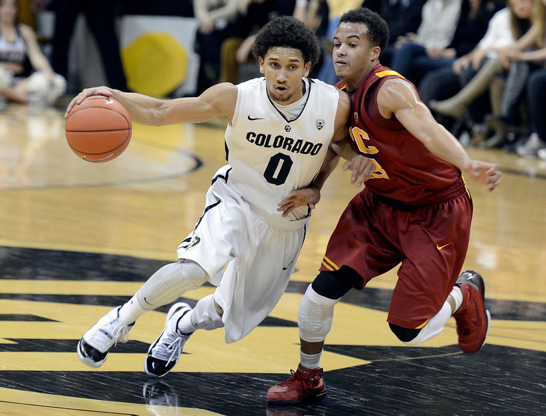 "University of Colorado's Askia Booker drives past Chass Bryan during a game against the University of Southern California on Thursday, Jan. 10, at the Coors Event Center on the CU campus in Boulder. For more photos of the game go to  <a href=""http://www.dailycamera.com"">http://www.dailycamera.com</a><br /> Jeremy Papasso/ Camera"