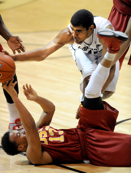 Chass Bryan of USC, bottom and Josh Scott of Colorado try to control a loose ball during the second half of the January 10, 2013 game in Boulder.<br /> Cliff Grassmick / January 10, 2013