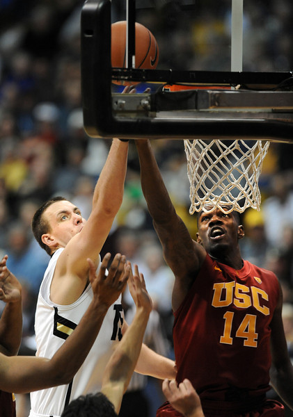 Shane Harris-Tunks, left,   of CU battles with DeWayne Dedmon of USC during the second half of the January 10, 2013 game in Boulder.<br /> Cliff Grassmick / January 10, 2013