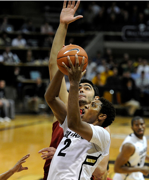 "University of Colorado's Xavier Johnson goes for a shot over Omar Oraby during a game against the University of Southern California on Thursday, Jan. 10, at the Coors Event Center on the CU campus in Boulder. For more photos of the game go to  <a href=""http://www.dailycamera.com"">http://www.dailycamera.com</a><br /> Jeremy Papasso/ Camera"