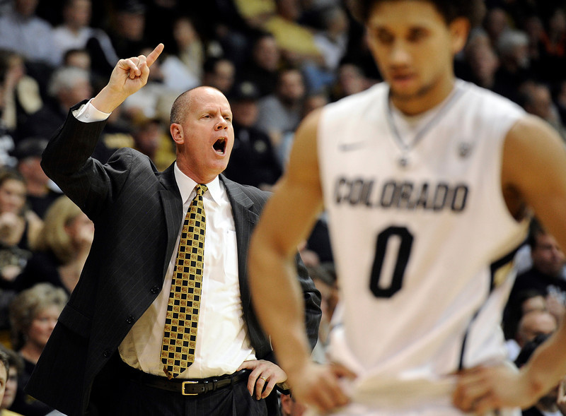 "University of Colorado head coach Tad Boyle yells to his players, including Askia Booker, at right, during a game against the University of Southern California on Thursday, Jan. 10, at the Coors Event Center on the CU campus in Boulder. For more photos of the game go to  <a href=""http://www.dailycamera.com"">http://www.dailycamera.com</a><br /> Jeremy Papasso/ Camera"