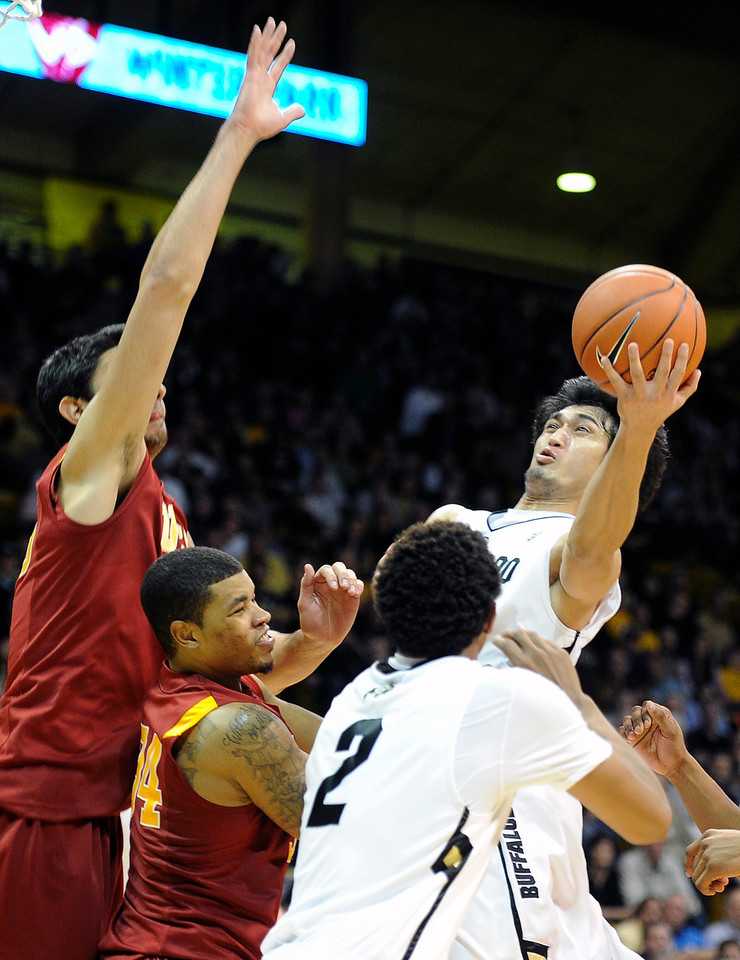 "University of Colorado's Sabatino Chen takes a shot over Eric Wise, center, and Omar Oraby during a game against the University of Southern California on Thursday, Jan. 10, at the Coors Event Center on the CU campus in Boulder. For more photos of the game go to  <a href=""http://www.dailycamera.com"">http://www.dailycamera.com</a><br /> Jeremy Papasso/ Camera"