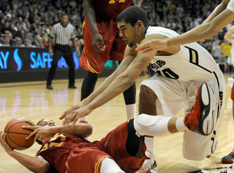 "University of Colorado's Josh Scott fights for a loose ball with Chass Bryan during a game against the University of Southern California on Thursday, Jan. 10, at the Coors Event Center on the CU campus in Boulder. For more photos of the game go to  <a href=""http://www.dailycamera.com"">http://www.dailycamera.com</a><br /> Jeremy Papasso/ Camera"