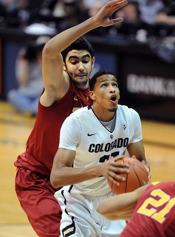Andre Roberson of CU gets covered up by Omar Oraby of USC during the second half of the January 10, 2013 game in Boulder.<br /> Cliff Grassmick / January 10, 2013