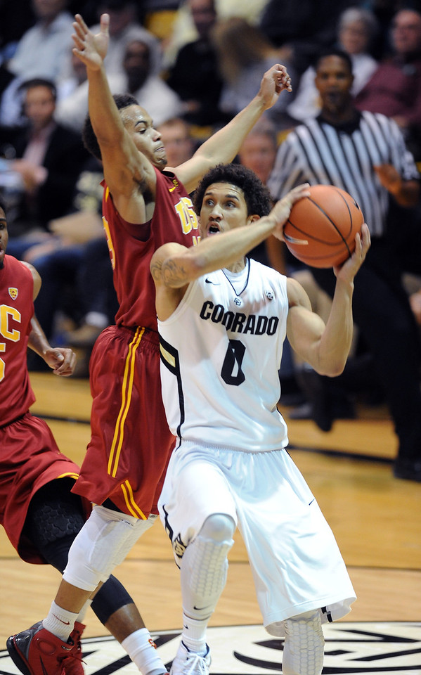Askia Booker of Colordo drives on Chass Bryan of USC during the second half of the January 10, 2013 game in Boulder.<br /> Cliff Grassmick / January 10, 2013