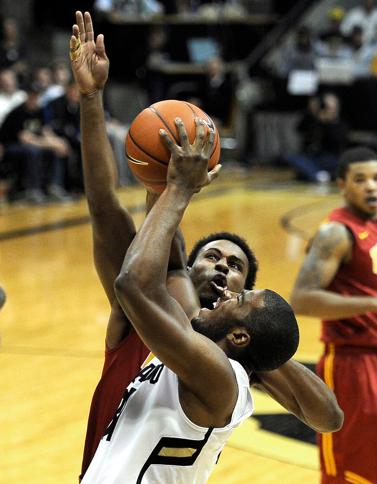 "University of Colorado's Jeremy Adams takes for a shot over Brendyn Taylor during a game against the University of Southern California on Thursday, Jan. 10, at the Coors Event Center on the CU campus in Boulder. For more photos of the game go to  <a href=""http://www.dailycamera.com"">http://www.dailycamera.com</a><br /> Jeremy Papasso/ Camera"