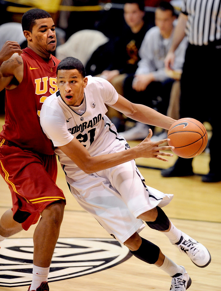 Andre Roberson of Colorado drives around Eric Wise of USC during the second half of the January 10, 2013 game in Boulder.<br /> Cliff Grassmick / January 10, 2013