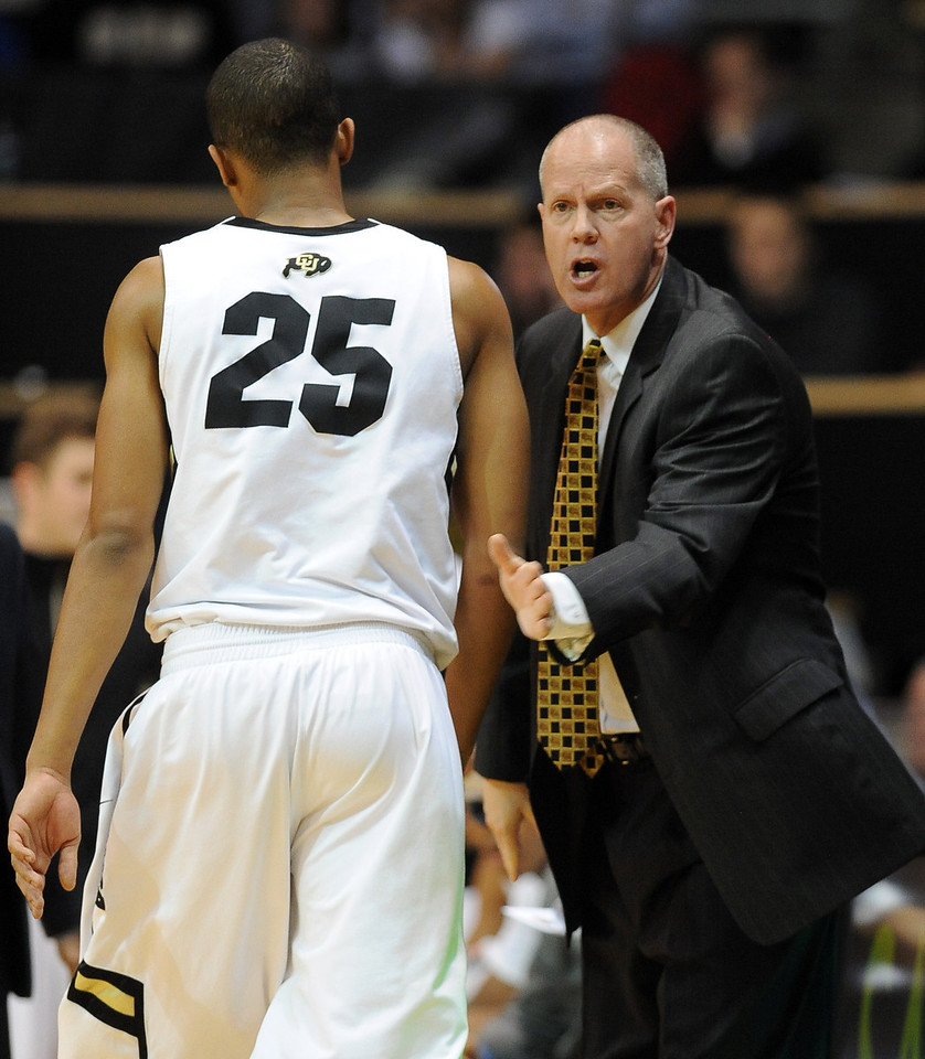 Tad Boyle encourages his team during the first half of the January 10, 2013 game in Boulder.<br /> Cliff Grassmick / January 10, 2013