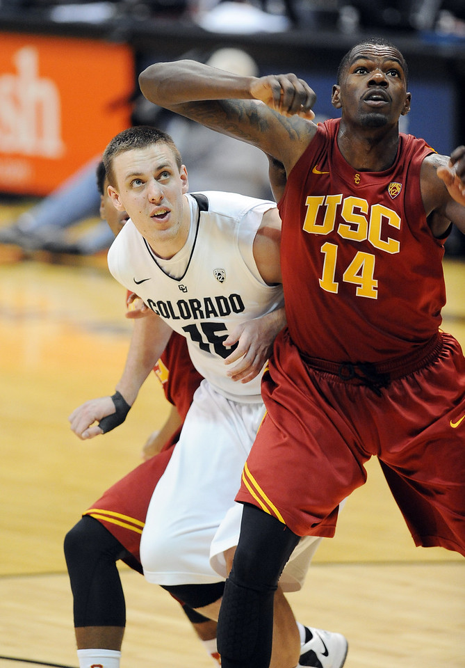 Shane Harris-Tunks  of CU battles with DeWayne Dedmon of USC during the second half of the January 10, 2013 game in Boulder.<br /> Cliff Grassmick / January 10, 2013