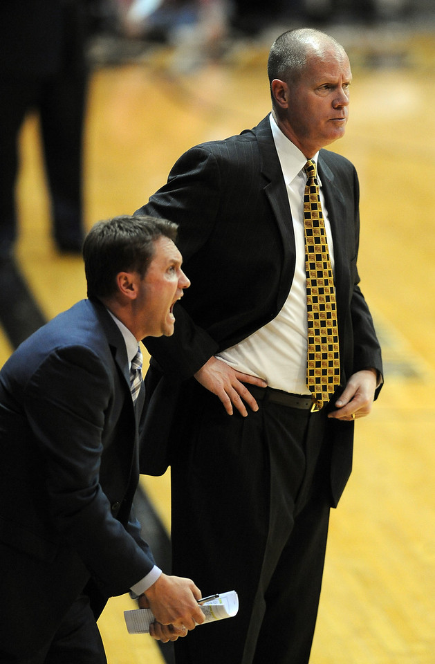 Tad Boyle, right,  encourages his team during the second half of the January 10, 2013 game in Boulder.<br /> Cliff Grassmick / January 10, 2013